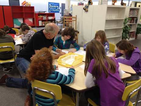 Steve helping students with their writing