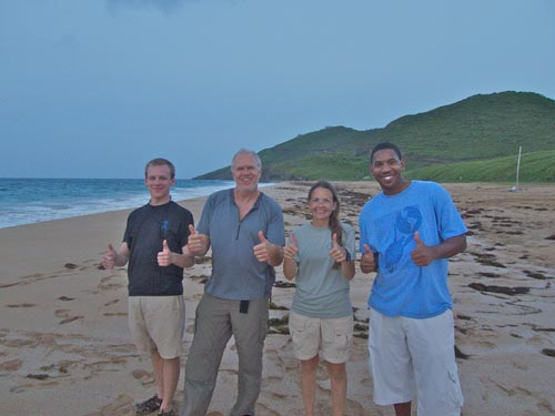 A band of happy (and tired) sea turtle researchers give thumbs up after a night of successful monitoring.